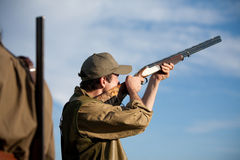 Hunter aiming the hunt during a hunting party Royalty Free Stock Photography