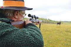 Hunter aiming at moose. A male hunter aiming at moose Royalty Free Stock Image