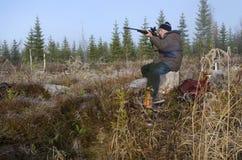 Hunter aiming Stock Photography