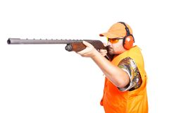 Hunter aiming pump action shotgun Royalty Free Stock Photos