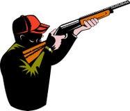 Hunter aiming a shotgun Royalty Free Stock Photo