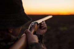 Hunter aiming shotgun stock image
