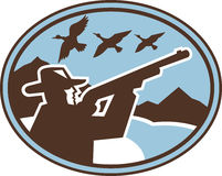Hunter aiming shotgun wild birds. Imagery shows a Hunter aiming his shotgun viewed from side with ducks flying in the background enclosed in an ellipse. Done in Royalty Free Stock Photos