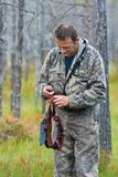 Hunter with bandolier Stock Images