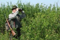 Hunter with binoculars Royalty Free Stock Photo
