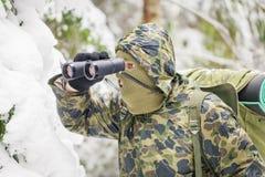 Hunter with binoculars Stock Photos