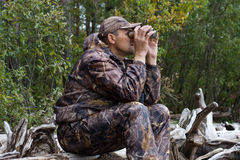 Hunter with binoculars looks out the game Stock Images