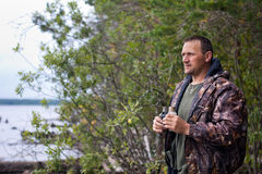 Hunter with binoculars Royalty Free Stock Image