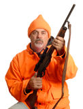 Hunter in blaze orange gear. Hunter holding rifle in blaze orange gear Royalty Free Stock Photography