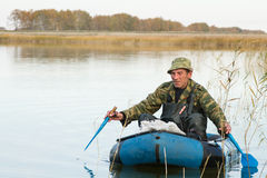Hunter in a boat Stock Photo