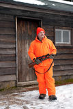 Hunter in Bright Orange by Cabin Stock Photo
