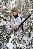 The hunter in the bushes in winter Stock Images