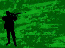 Hunter on the camouflage background Royalty Free Stock Image