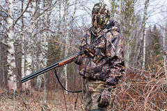Hunter in the camouflage with gun Royalty Free Stock Images