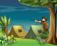 A hunter in a campsite Stock Photos