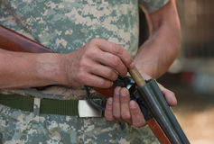 The hunter charges a shot-gun Stock Photo