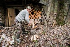 Hunter chopping wood Stock Photography