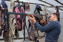 Hunter cleaning gun in the camp Stock Photography