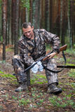 Hunter cleaning shotgun Royalty Free Stock Photography