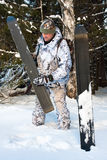 Hunter cleans skis Royalty Free Stock Photography