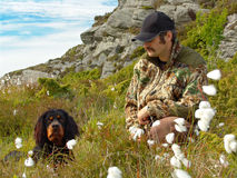 Hunter and Dog. A hunter and his dog (Gordon Setter) in cotton grass Royalty Free Stock Photography