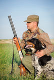 Hunter with a dog Stock Photos