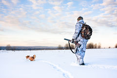 Hunter with a dog on a frosty day Stock Photo