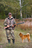 Hunter and dog outdoors Stock Photography
