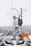 The hunter with dog pass railway Royalty Free Stock Photos