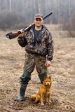 Hunter with a dog Stock Image
