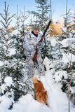 Hunter with dog in the snowy forest Royalty Free Stock Image