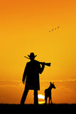Hunter with dog at sunset Stock Photos