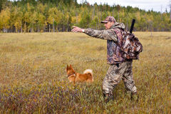 Hunter with dog on the swamp Stock Images