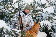 Hunter with dog in winter forest stock photos