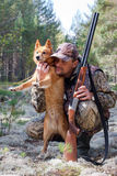 Hunter embraces his dog Stock Photography