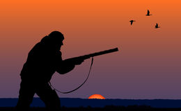 Hunter in the evening. Silhouette of man on the hunting Stock Images
