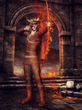 Hunter with fiery arrows. Fantasy hunter with fiery bow and arrows standing in ruins of a castle Royalty Free Stock Photography