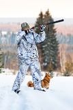 Hunter with Finnish Spitz in winter Stock Images