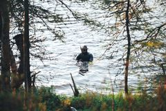 Hunter Fisherman is Hunting a Fish on the River Stock Photos