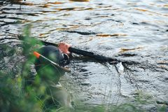 Hunter Fisherman is Hunting a Fish on the River Royalty Free Stock Image