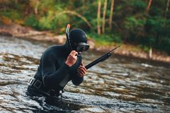 Hunter Fisherman is Hunting a Fish on the River Stock Image