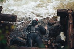 Hunter Fisherman in Wetsuit with a Speargun Looks Under the Water in Search of Fish Stock Photo