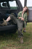 Hunter girl sleeping. In  off-road car Royalty Free Stock Images