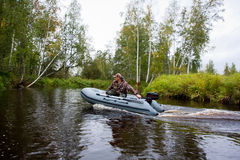 Hunter goes in a boat. Hunter goes in a  motor boat Stock Image