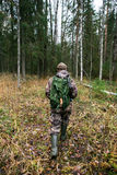 Hunter goes through the forest Stock Photography