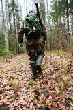 Hunter goes through the forest Stock Photo