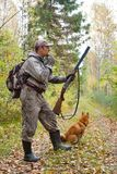 Hunter with a grouse call. In the forest Royalty Free Stock Photos