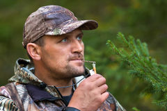 Hunter with a grouse call Royalty Free Stock Images