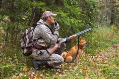 Hunter with a grouse call and shotgun. Hunter with a grouse call waiting a prey Stock Photos