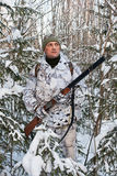 The hunter with gun in the bushes in winter Stock Photography